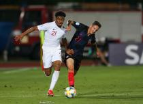 Reiss Nelson of England challenged by Domagoj Bradaric of Croatia during the UEFA Under-21 Championship 2019 match at San Marino Stadium, Serravalle. Picture date: 24th June 2019.
